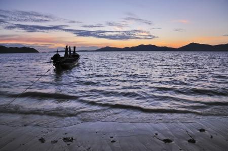 Fisherman s boat silhouette at sunset, Andaman sea phuket Thailand photo