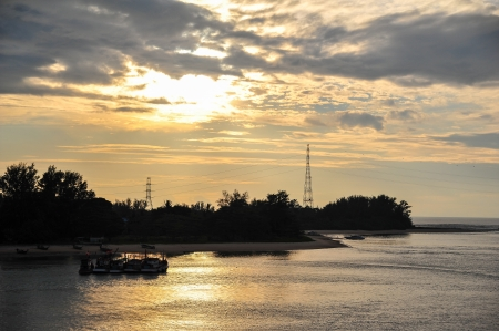 group of Fisherman s boat silhouette at sunset, Andaman sea phuket Thailand  photo
