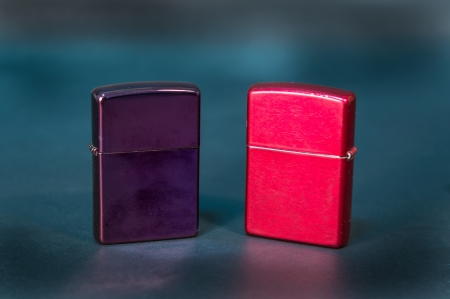 purple and red metal lighter on black background  photo