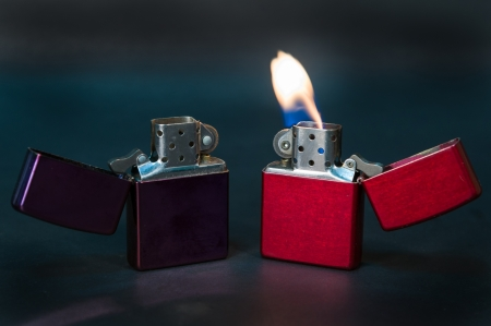 purple and red metal lighter on black background Stock Photo - 20912709