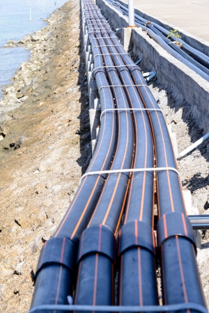 HDPE pipes beside bridge  Stock Photo