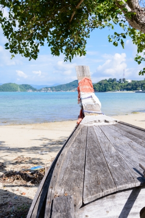 traditional Thai Long tailed boat head at phuket beach, Thailand  photo
