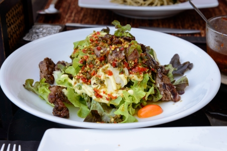 Spicy grilled pork salad with vegetables  photo
