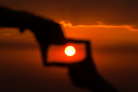 silhouette of hand to catch the sun  photo
