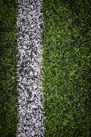goalline:  Photo of a green synthetic grass sports field with white line shot from above  Stock Photo