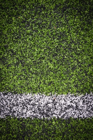 sideline:  Photo of a green synthetic grass sports field with white line shot from above  Stock Photo