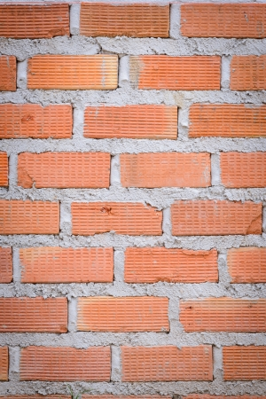 hollow walls:  house wall under construction with red bricks  Stock Photo