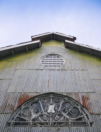 old metal sheet facade and window at market, Myanmar  photo