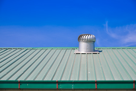 Metal Roof: Turbine Roof Ventilation System On Top Of Metal Sheet Roof