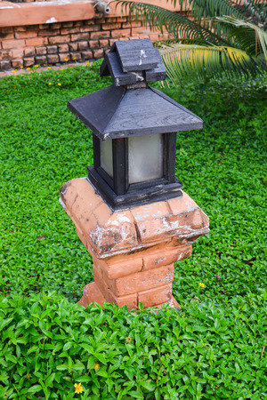 Asian style lamp in garden with leaves covered  photo