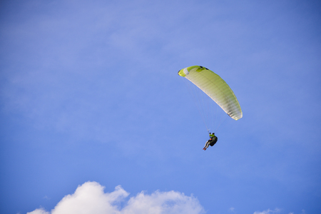 flight helmet: Paragliding extreme Sport with blue Sky and clouds
