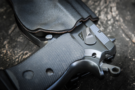handgun in holster ready to firing position with safety on