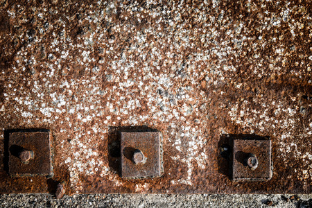 pitting: Rusty fragments of a hexagonal bolt head with flange