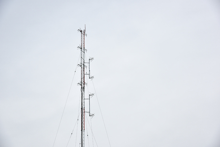 post: telecom post on the cloudy sky Stock Photo