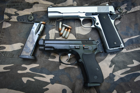 Semi-automatic guns and bag on soldier pant Stock Photo