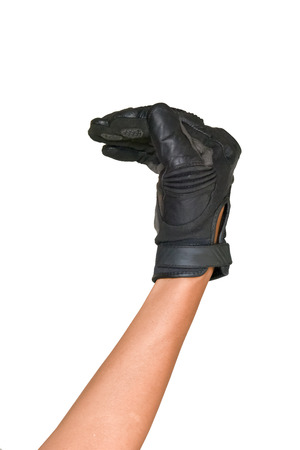Motorcycle glove and hand signal to turn left isolated on white background