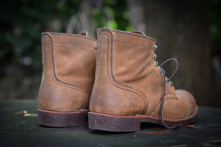 Men Brown suede boots on grungy wood