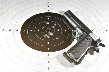 handgun and shooting target