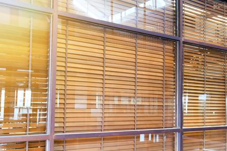 wooden blind behind the fixed glass window Standard-Bild
