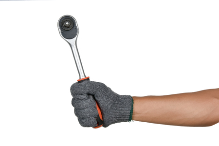 a hand with protection glove holding ratchet (socket) wrench Stock Photo