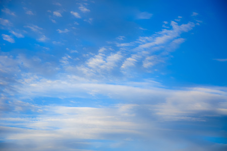 a blue sky with light clouds abstract background