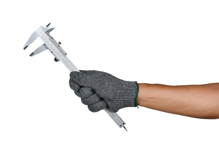 a hand with protection glove holding Vernier calipers