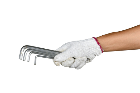 a hand with protection glove holding a various allen keys spanner on white background