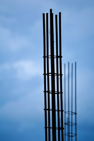 silhouette reinforce iron rack in a construction site under blue sky
