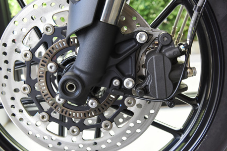 close up of Motorcycle disk brake with ABS system Stock Photo