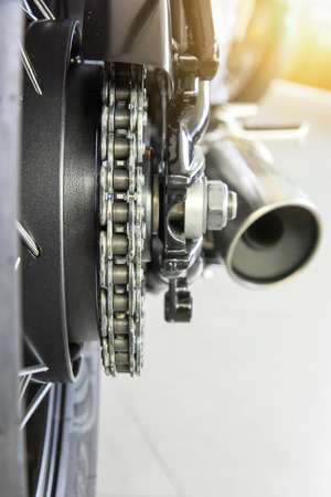 close up of motorcycle rear drive chain with selected focus shallow depth of field