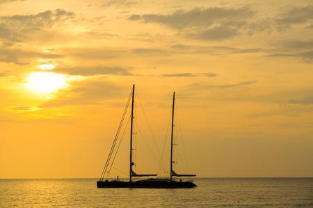 silhouette of sailing yacht in Beautiful Sunset at andaman sea,Phuket Thailand
