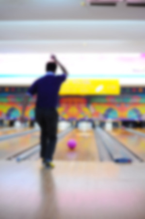 blurred of a man playing bowling
