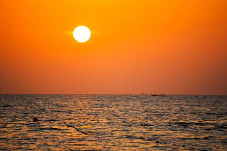 Fisherman boat silhouette at sunset, Andaman sea phuket Thailand