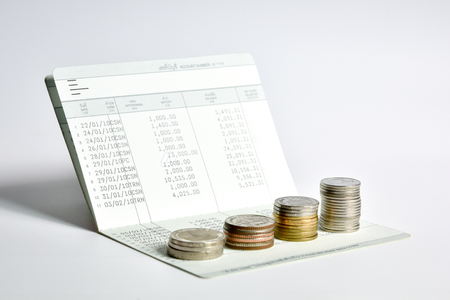 stack of coins step up on bank saving account book, financial and money savings management concept Stock Photo