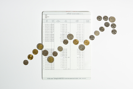coins array to show graph grow up on bank saving account book, grow up financial and money savings management concept Stock Photo - 81074151