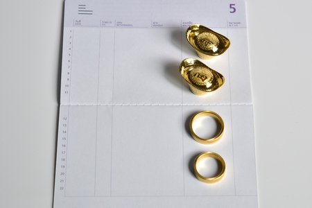 a gold ring and chinese money gold on bank saving account book, financial and money savings management concept Stock Photo