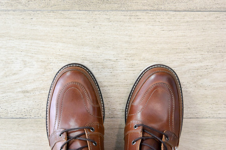male brown leather shoes on wooden pattern tile floor Stock Photo