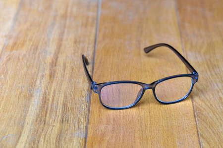 Clear eyeglasses, Glasses transparent grey Frame vintage style on wood background