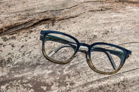 Clear eyeglasses, Glasses transparent dark blue frame Vintage style on grungy wood background