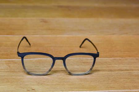 Clear eye glasses, Glasses transparent dark blue frame vintage style on wood background