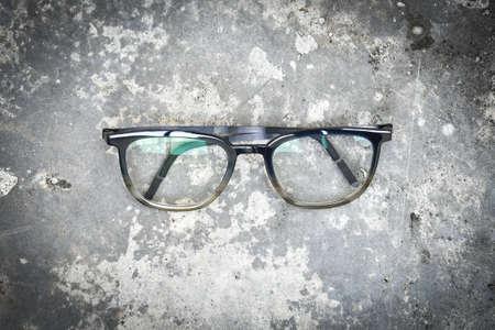 Clear eyeglasses, Glasses transparent dark blue frame Vintage style on grungy concrete cement floor background
