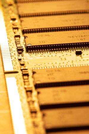 close up of a computer RAM memory in brown color.  Imagens