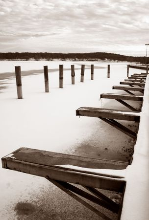 frozen lake: dock landscapes near a frozen lake covered with snow in a cold winter.
