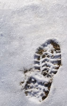 a large hiking footprint on white snow. Stock Photo