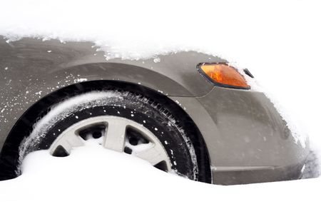 a cars front part buried in snow after a blizzard