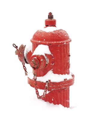 red fire hydrant buried by snow in a blizzard day.