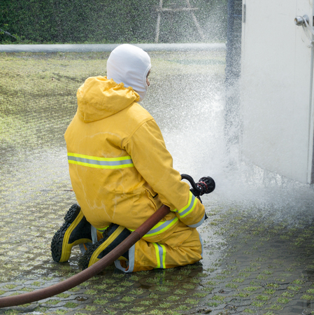 preparedness: Firefighter fighting for a fire attack, During  training exercis Stock Photo
