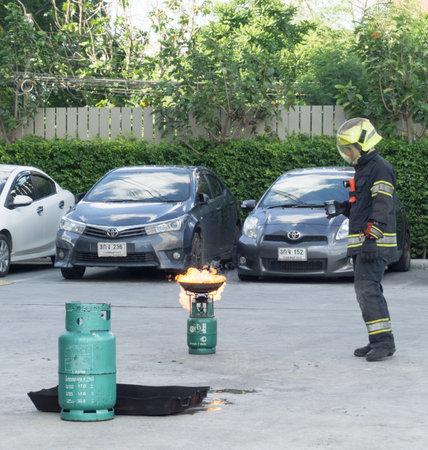 fireman: BANGKOK, THAILAND- JULY 31: Fire training by a firefighter on July 31, 2016 in Bangkok, Thailand.