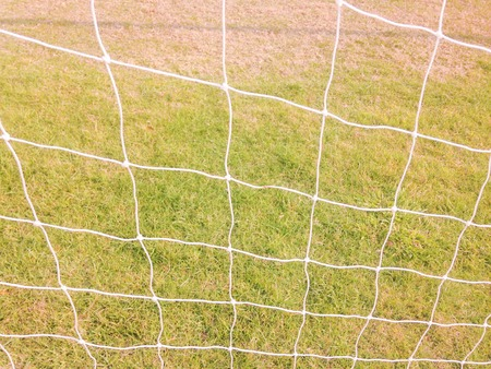 Soccer football net with green grass background Stock Photo