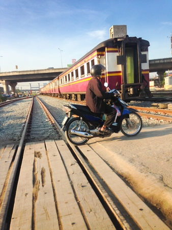 casualty: Man driving motorcycle crossing railroad, risk when crossing rails.